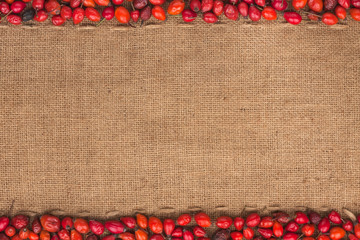 Rosehip lying on sackcloth