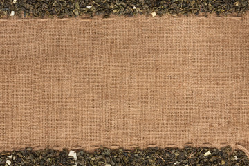 Green tea  lying on sackcloth
