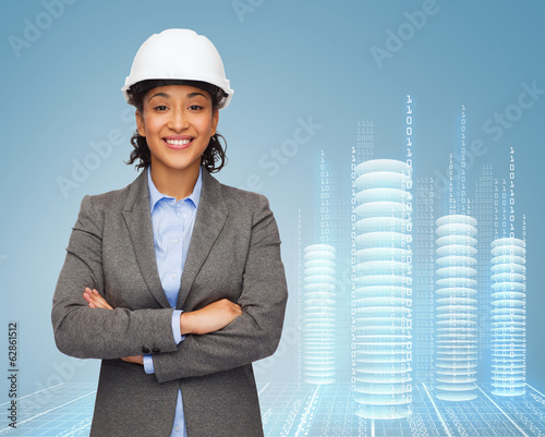 businesswoman in white helmet with crossed arms