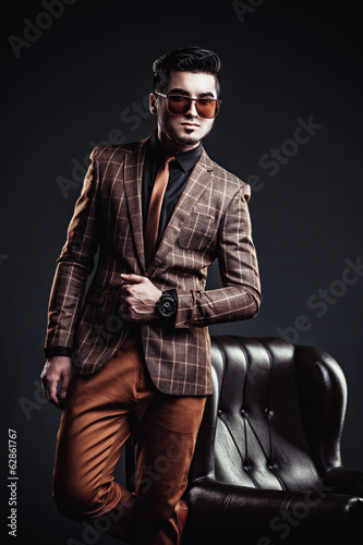 Portrait of handsome stylish man in elegant brown jacket