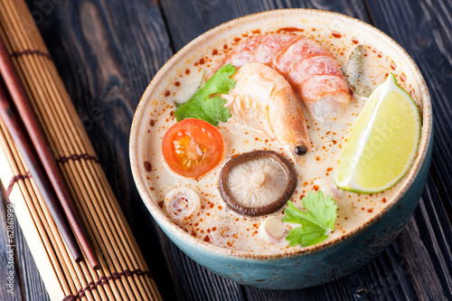 Spicy Thai Tom Yam soup with coconut milk. Sea Food Thai.