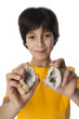 Eight year old boy shows geodes
