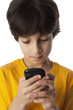 Eight year old boy reading text message