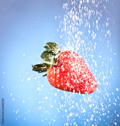 red strawberry sprinkled with white sugar