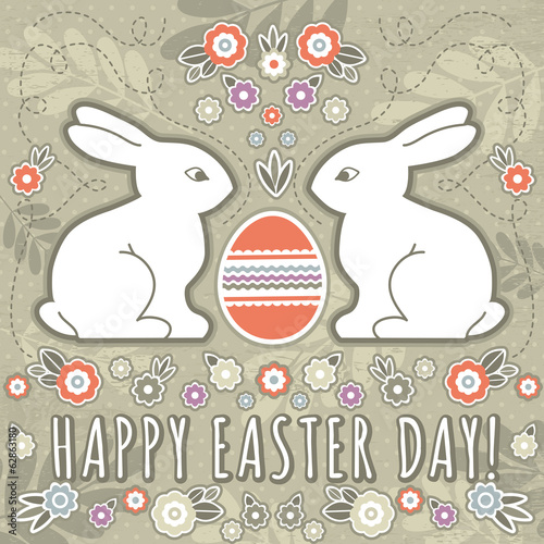 greetings card with easter eggs and two rabbits