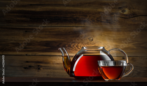 Fotobehang Thee glass teapot with black tea on wooden background