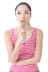 Asian girl take a microphone singing or speak