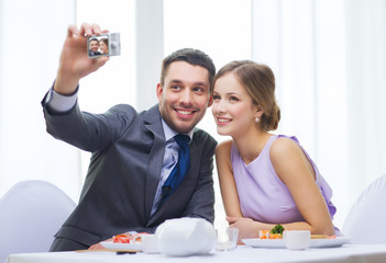 smiling couple taking self portrait picture