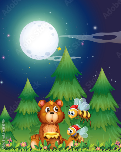 A bear near the pine trees with Santa bees