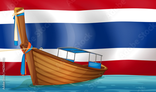A boat in front of the Thai flag