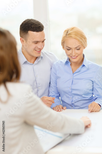smiling couple at bank