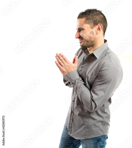Handsome man pleading over isolated white background