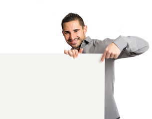 handsome man holding an empty cardboard over white background