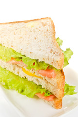 Sandwich with salmon on white background
