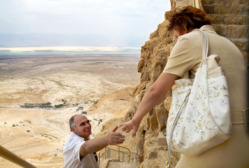Elderly couple traveling in mountains above the Dead Sea