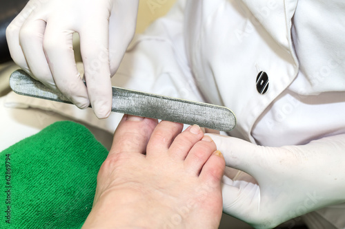 process of pedicure at beauty salon