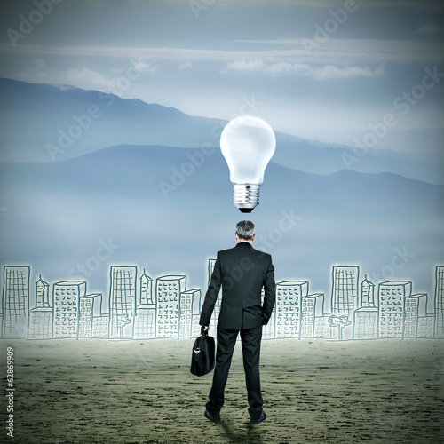 idea concept businessman with city skyline