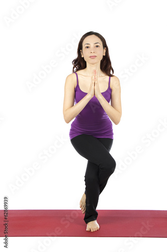 Woman doing Eagle pose in yoga