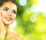 Fototapety Beauty spa woman over nature green background. Spring