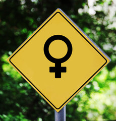 Yellow traffic label with woman gender pictogram