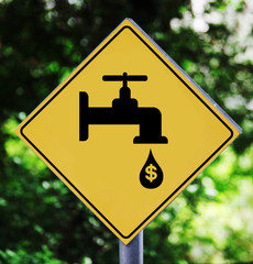 Yellow traffic label with leaking faucet pictogram