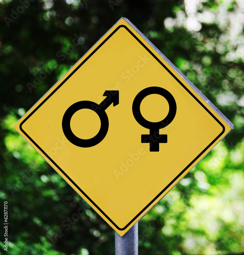Yellow traffic label with man and woman gender pictogram