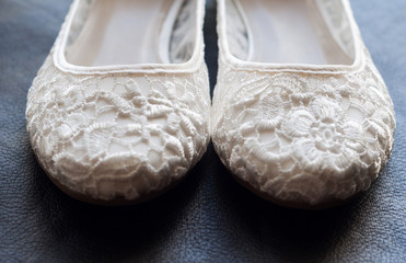 Beautiful white lace bridal shoes