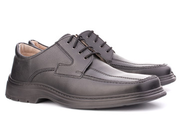 Black glossy man's shoes with shoelaces