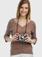 Beautiful and happy woman holding an old photography camera
