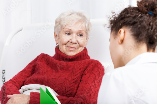 Elderly lady listening to nurse