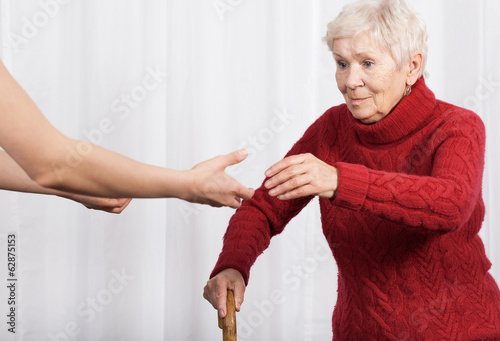 Elderly woman trying to walk