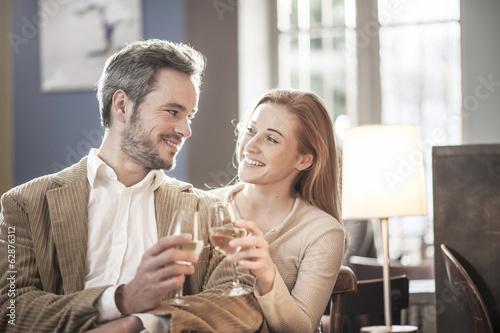 young couple toasting in a bar