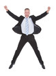 Exultant businessman cheering