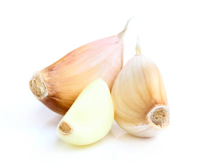 Three cloves of garlic closeup.
