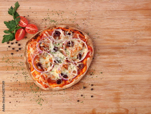 Thin crust pizza on wooden block