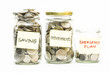 Coins in jar with saving, retirement and emergency plan label