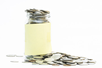 Isolated coins in jar with copy space