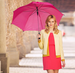 Smart woman waling with umbrella
