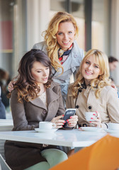 Three fabulous women drinking coffee