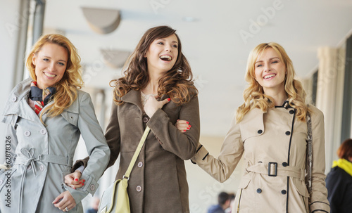 Three cheerful ladies walking during the spring day