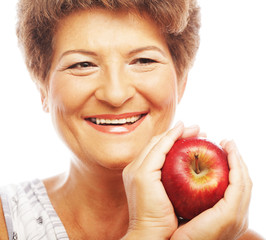 Mature smiling woman with apple