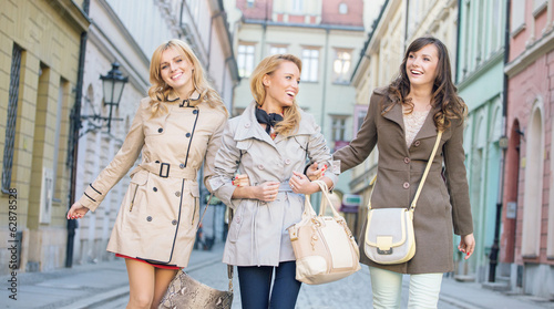 Female friends walking and laughing