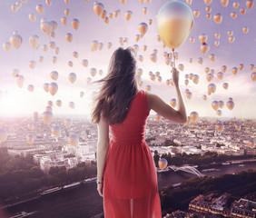 Young lady and the city of the balloons