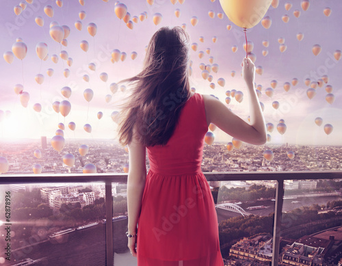 Young woman staring at thousands of the balloons