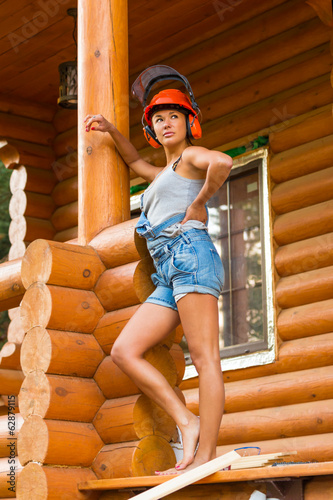 Pretty young woman builder