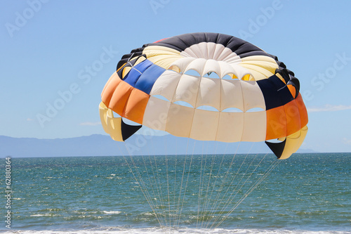 Brilliant parachute over the beach.