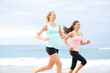 Runners - two women running outdoors