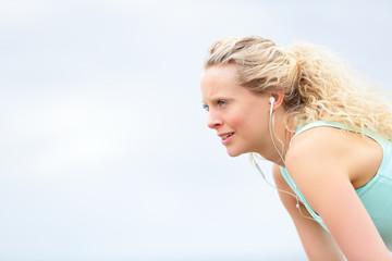 Runner woman resting after running workout