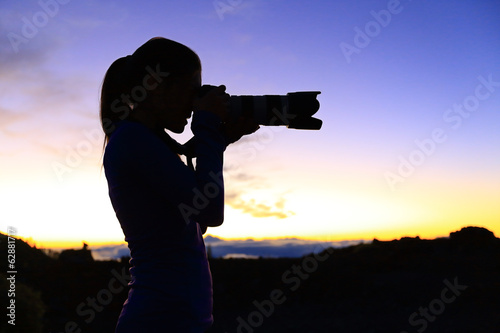 Photographer taking pictures with SLR camera