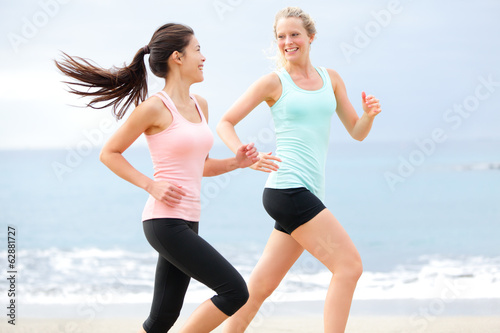 Exercise running women jogging happy on beach